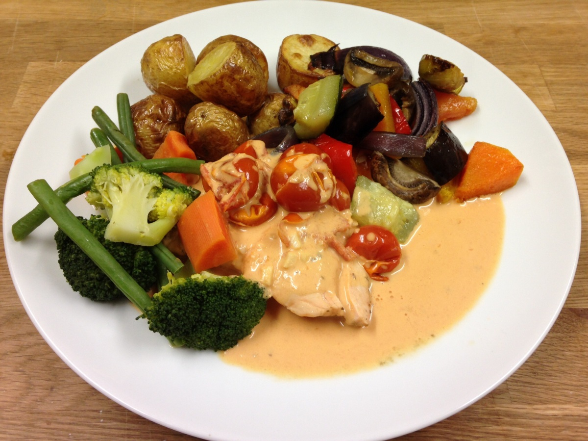 Poached Salmon in a Creamy Tomato Sauce