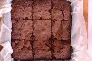 Triple Chocolate Fudgy Brownies - Gorgeously fudgy squares of chocolate brownie filled with milk and white chocolate chunks. | thehecticcook.com