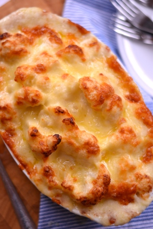Cauliflower Cheese - Florets of cauliflower smothered in a thick cheese sauce, topped with melted golden cheddar, this is the ultimate side dish, or a meal in itself! | thehecticcook.com